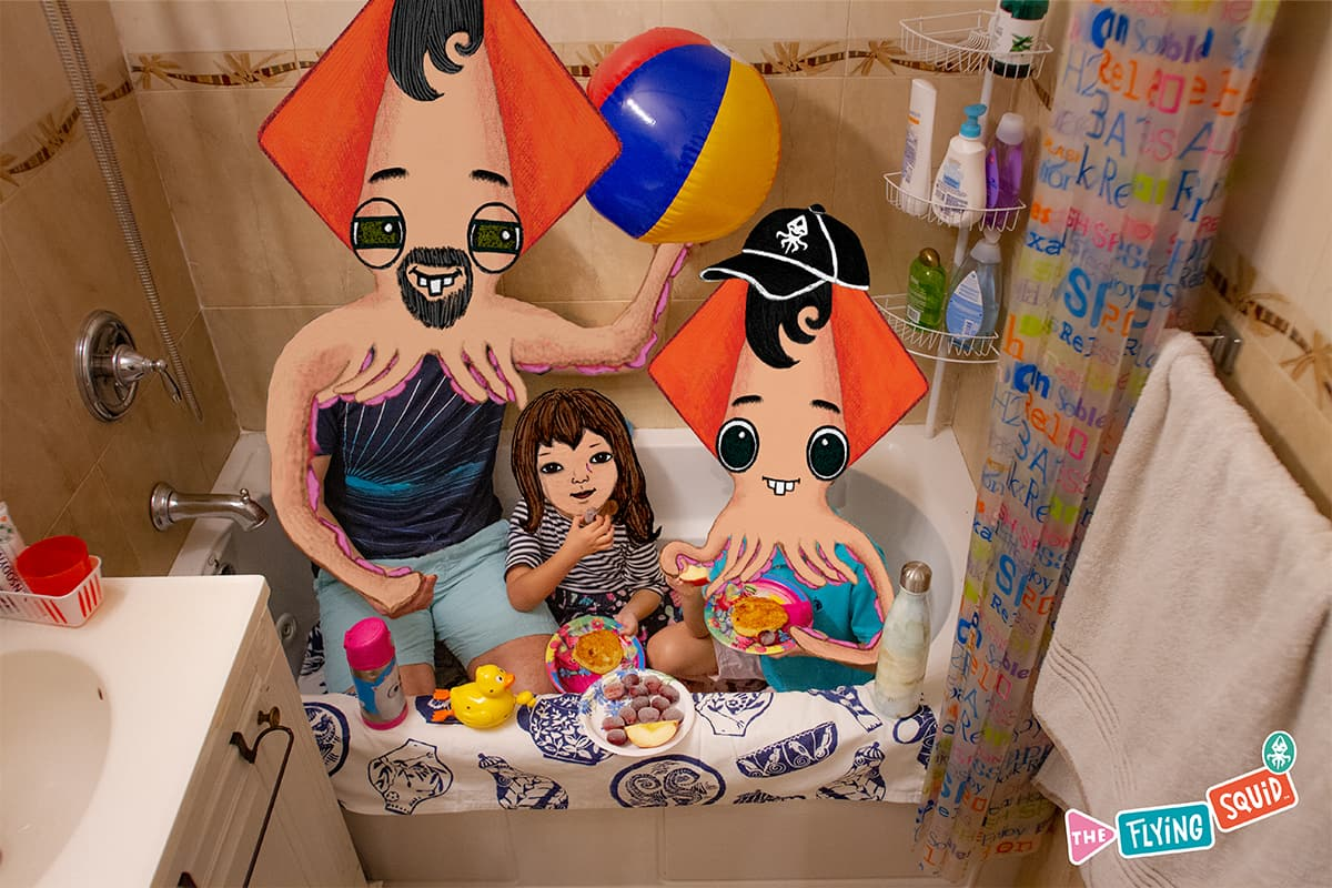 A father with his daughter and son, enjoy doing fun activities for kids. They are doing a picnic in a bathtub.